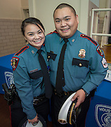 """Minhnguyet """"Nicky"""" Tran, left, gets a hug from her brother Tridung Tran, right, following a swearing-in ceremony for new officers at the Houston ISD Police Department, March 3, 2014."""
