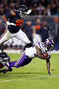 Chicago Bears defensive end Cornelius Washington (90) jumps into the action as Minnesota Vikings running back Ronnie Hillman (33) dives for extra yardage on a fourth quarter pass reception during the 2016 NFL week 8 regular season football game against the Minnesota Vikings on Monday, Oct. 31, 2016 in Chicago. The Bears won the game 20-10. (©Paul Anthony Spinelli)
