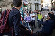 Protester from the remain side of the Brexit debate has a discussion with a few older leave campaign protesters outside The Supreme Court as the second day of the hearing to rule on the legality of suspending or proroguing Parliament begins on September 18th 2019 in London, United Kingdom. The ruling will be made by 11 judges in the coming days to determine if the action of Prime Minister Boris Johnson to suspend parliament and his advice to do so given to the Queen was unlawful.
