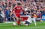 Fulham midfielder Ryan Tunnicliffe slides in to bring down Middlesbrough FC striker Diego Fabbrini during the Sky Bet Championship match between Middlesbrough and Fulham at the Riverside Stadium, Middlesbrough, England on 17 October 2015. Photo by George Ledger.