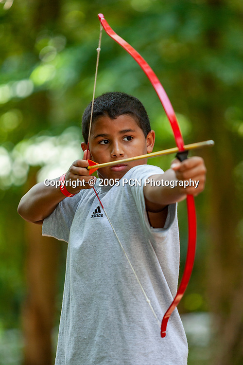 Boys playing archery at day camp.