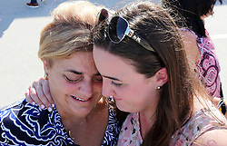Ingrid Fernandez, of Puerto Rico, breaks down in tears as her daughter, Ingrid Vazquez, of Kendall comforts her after she arrived at Port Everglades Tuesday morning, Oct. 3, 2017. Sanchez was an evacuee onboard Royal Caribbean's Adventure of the Seas. The cruise ship picked up more than 3,000 evacuees in Puerto Rico, St. Thomas and St. Croix. The ship returned to Port Everglades in Fort Lauderdale Tuesday morning, Oct. 3, 2017. (Emily Michot/Miami Herald/TNS)