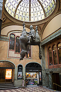 In the marbled atrium where the tickets can be bought for the cinema, hangs David Cerny's sculpture called Kun, an equestrian sculpture of  St Wenceslas in Wenceslas Square in Lucerna Gallery, on 19th March, 2018, in Prague, the Czech Republic. Lucerna is the most elegant of Nove Mesto's many shopping arcades runs through the art-nouveau Lucerna Palace (1920), between Stepanska and Vodickova streets. The complex was designed by Vaclav Havel (grandfather of the former president), and is still partially owned by the family. It includes theatres, a cinema, shops, a rock club and several cafes and restaurants. Here St Wenceslas sits astride a horse that is decidedly dead; it's safe to assume this is a reference to Vaclav Klaus, president of the Czech Republic from 2003 to 2013.