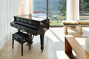 Interior of a modern apartment furnished, lounge with piano
