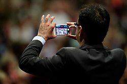 © Licensed to London News Pictures. 28/09/2016. Liverpool, UK. A delicate using his phone to record  Jeremy Corbyn deliver his leaders speech at day four of the Labour Party Annual Conference, held at the ACC in Liverpool, Merseyside, UK. Photo credit: Ben Cawthra/LNP