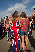 London, UK. Thursday 9th August 2012. London 2012 Olympic Games Park in Stratford. Fans of Team GB dressed in Union Jack flags. Patriotism seems to have taken a huge surge during the games.