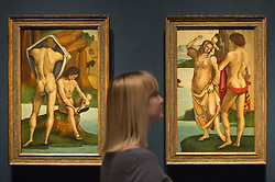 """© Licensed to London News Pictures. 28/02/2019. LONDON, UK. A staff member views """"Figures in a Landscape: Two Nude Youths"""" and """"Man, Woman and Child"""", both c1490 by Luca Signorelli. Preview of """"The Renaissance Nude"""", an exhibition at the Royal Academy of Arts in Piccadilly of 90 works examining the emergence of the nude in European art.  Works by artists including Leonardo da Vinci to Michelangelo are on display in the Sackler Galleries 3 March to 2 June 2019.  Photo credit: Stephen Chung/LNP"""