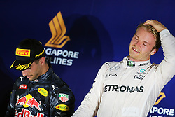 Race winner Nico Rosberg (GER) Mercedes AMG F1 (Right) celebrates on the podium with second placed Daniel Ricciardo (AUS) Red Bull Racing.<br /> <br /> - www.xpbimages.com, EMail: requests@xpbimages.com - copy of publication required for printed pictures. Every used picture is fee-liable. © Copyright: Charniaux / XPB Images beim GP von Singapur 2016 in Singapur / 180916<br /> <br /> *** Formula One Grand Prix of Singapore at Marina Bay Street Circuit on September 18, 2016 in Singapore ***