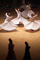 """Turquie. Anatolie Centrale. Ville de Konya. Le grand maitre soufi Djalal ed-Din Rumi ou Djalal-e-Din Mohammad Molavi Rumi ou Djalaleddine Roumi (1207-1273), fondateur de l'ordre des derviches tourneurs est connu sous le nom de Mevlana. Il est enterre a Konya. Le Sema est une danse sacree des derviches tourneurs soufis qui s'execute dans le semahane (salle de danse).Le derviche est vetu d'une longue tunique blanche, couleur du deuil, et d'une toque cylindrique en poil de chameau, symbole de la pierre tombale. La main droite levee vers le ciel, il recueille la grace divine qu'il transmet a la terre par la main gauche tournee vers le sol. Il pivote sur le pied gauche en tracant un cercle au tour de la piste pour parvenir a l'extase qui lui permet de s'unir a Dieu. La danse est donc une priere, un depassement de soi et l'union supreme avec Dieu. Le cercle est egalement le symbole de la Loi religieuse qui embrasse la communaute musulmane toute entiere et ses rayons symbolisent les chemins menant au centre ou se trouve la verite supreme, le dieu unique qui est l'essence meme de l'Islam. Chaque annee pou l'anniversaire de la mort de Mevlana les derviches se retrouvent a Konya pour une ceremonie. // Turkey. Central Anatolia. City of Konya. The sufi master Djalal ed-Din Rumi ou Djalal-e-Din Mohammad Molavi Rumi ou Djalaleddine Roumi (1207-1273), founded of whirling dervishes order is knows with the name of Mavlana. Is bury in Konya. Sema or sama is a term that means hearing in Arabic and Persian. It is used to refer to some of the ceremonies used by various sufi orders and often involves prayer, song, dance, and other ritualistic activities. Sema dancing is known to Europeans as the dance of the Whirling Dervishes or """"Sufi whirling"""", although many forms of sema do not include whirling. In the Mevlani sufi tradition, sema represents a mystical journey of spiritual ascent through mind and love to """"Perfect."""" In this journey the"""