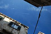 View of sky between buildings in narrow street, Dubrovnik old town, Croatia
