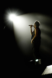 """Shane Filan in the spotlight during when Westlife play their third consecutive concert at the Hallam FM Arena at the start of their """"Unbreakable"""" Tour 2003 Monday 21st July 2003<br /> <br /> Image Copyright Paul David Drabble<br /> 21 July 2003"""