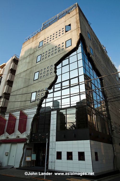 """East Gallery, despite its name, is a unique building in Ebisu, Shibuya-ku, Tokyo.  Often called the """"cracked building"""" because of its facade, it houses several upscale restaurants within, and a wedding hall."""