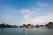 Panorama or limestone karsts and islands in Ha Long Bay on a sunny day with blue sky, near Cat Ba Island, Vietnam