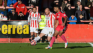 Jason Taylor clears the ball during the The FA Cup match between Cheltenham Town and Dover Athletic at Whaddon Road, Cheltenham, England on 7 December 2014.