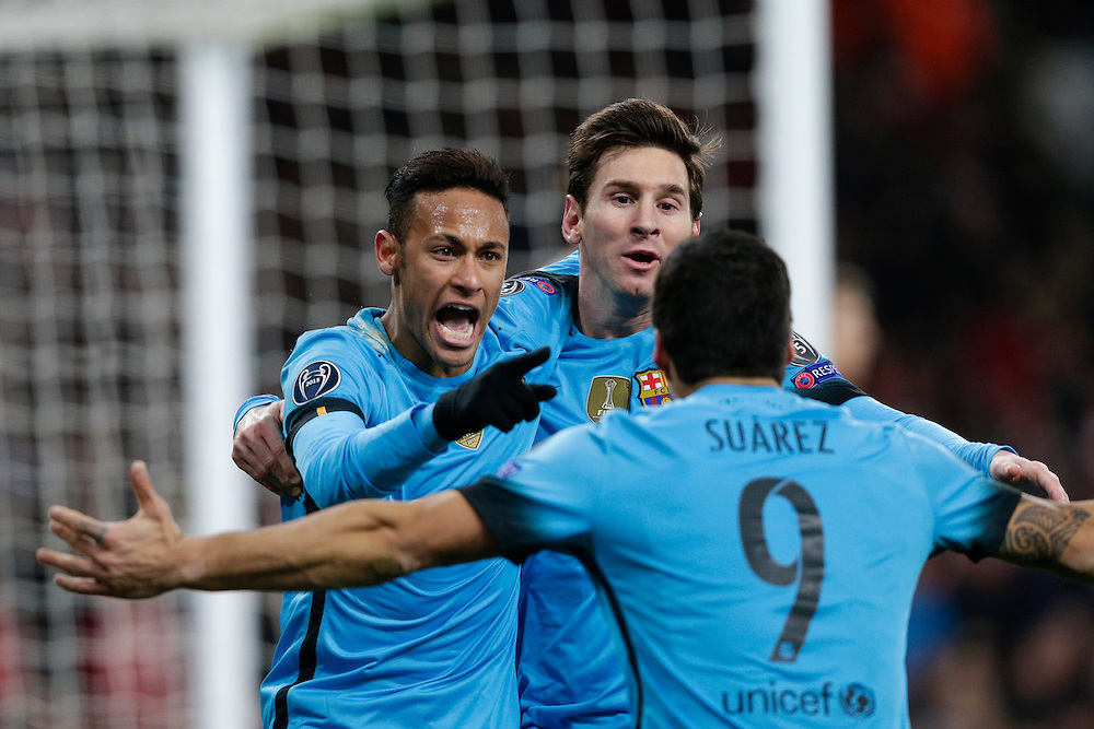 GOAL CELEBRATION - Barcelona's Lionel Messi celebrates scoring the opening goal with Neymar (left) and Luis Suarez<br /> <br /> Photographer Craig Mercer/CameraSport<br /> <br /> Football - UEFA Champions League Round of 16 - Arsenal v Barcelona - Tuesday 23rd February 2016 - Emirates Stadium - London<br /> <br /> © CameraSport - 43 Linden Ave. Countesthorpe. Leicester. England. LE8 5PG - Tel: +44 (0) 116 277 4147 - admin@camerasport.com - www.camerasport.com