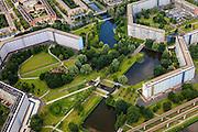 Nederland, Noord-Holland, Amsterdam, 14-06-2012; Amsterdam Zuidoost, episch centrum van de Bijlmerramp: de vierkante waterpartij in het midden. Verscholen onder de bomen, direct boven het vierkant, het Bijlmermonument. Links de flat Kruitberg, de contouren van de getroffen flat Klein-Kruitberg en Groeneveen zijn zichtbaar in het gras, rechts het nog bestaande deel van Groeneveen. .Remaining high-rise the classic honeycomb flats in the south-east of Amsterdam (Bijlmermeer).  On this site an El AL airplane crashed in 1992 (Bijlmer airplane disaster).  .luchtfoto (toeslag), aerial photo (additional fee required).foto/photo Siebe Swart