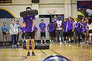 Milpitas High School seniors toss a tire over their head during the Over, Under, and Through race during the annual Trojan Olympics, where students compete in various unorthodox events for class bragging rights, at Milpitas High School in Milpitas, California, on March 27, 2015. (Stan Olszewski/SOSKIphoto)