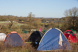Harefield, UK. 19 January, 2020. A camp pitched by activists from Extinction Rebellion, Stop HS2 and Save the Colne Valley attending a 'Stand for the Trees' event timed to coincide with tree felling work for the high-speed rail link on land from which bailiffs acting for HS2 had evicted activists living in the Colne Valley wildlife protection camp almost two weeks previously. 108 ancient woodlands are set to be destroyed by the high-speed rail link.