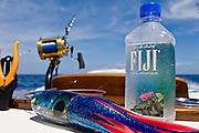 Bottle of Fiji water on rocket launcher.