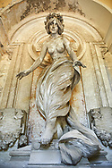 Picture and image of the Art Nouveau stone sculpture of a nude. The Pizzorini Tomb by Vittorio  Lavezzari 1906. Section A, no 33, The monumental tombs of the Staglieno Monumental Cemetery, Genoa, Italy .<br /> <br /> Visit our ITALY PHOTO COLLECTION for more   photos of Italy to download or buy as prints https://funkystock.photoshelter.com/gallery-collection/2b-Pictures-Images-of-Italy-Photos-of-Italian-Historic-Landmark-Sites/C0000qxA2zGFjd_k<br /> If you prefer to buy from our ALAMY PHOTO LIBRARY  Collection visit : https://www.alamy.com/portfolio/paul-williams-funkystock/camposanto-di-staglieno-cemetery-genoa.html
