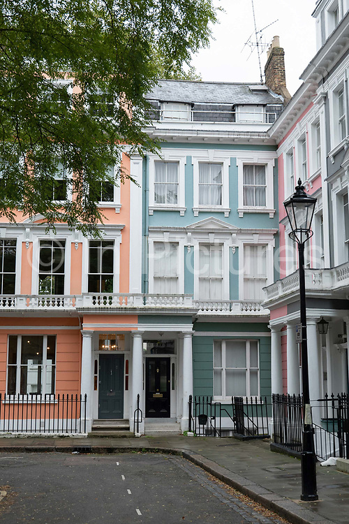 Large colourful Victorian family houses at Chalcot Square on the 7th October 2019 in London in the United Kingdom.