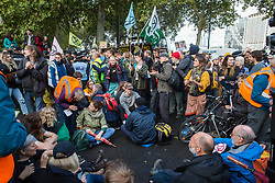 London, UK. 13 October, 2019. Climate activists from Extinction Rebellion, including disabled activists in wheelchairs, protest outside New Scotland Yard against tactics employed by police officers which impinge on the right to protest of disabled activists, including the confiscation of wheelchairs, wheelchair ramps, accessible toilets and tents. It was the seventh day of International Rebellion protests by Extinction Rebellion.