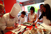 """Lenotre Ecole Culinaire, Paris,..short course - """"Return to the Market"""" with Chef Jacky Legras.Chef demonstrates fileting the mackerel...photo by Owen Franken for the NY Times..July 12, 2007......."""