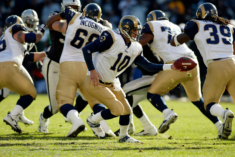 St. Louis Rams quarterback Marc Bulger (10) hands off to running back Steven Jackson during the second quarter of an NFL football game against the Oakland Raiders, Sunday, Dec. 17, 2006 at McAfee Coliseum in Oakland, Calif. The Rams won, 20-0. (D. Ross Cameron/The Oakland Tribune)