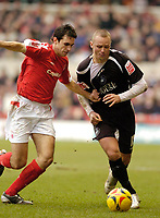 Photo: Leigh Quinnell.<br /> Nottingham Forest v Swansea. Coca Cola League 1. 11/02/2006. Nottingham Forrests John Thompson grabs hold of Swanseas Lee Trundle.