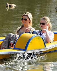 © Licensed to London News Pictures. 11/03/2012. Oxford, UK. Two girls are paddled along the river. People enjoy the early morning sunshine on the River Cherwell in Oxford today 11 March 2012. Photo credit : Stephen SImpson/LNP