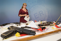"© Licensed to London News Pictures . 07/08/2014 . Manchester , UK . Detective Chief Inspector Debbie Dooley of GMP's "" Xcalibre Task Force "" , which tackles gun-related crime , with some of the cache . Greater Manchester Police displays some of the cache of firearms and ammunition they collected during a two week firearms amnesty in July , at the force's North Manchester headquarters , this morning (7th August 2014) . GMP reports collecting 225 firearms and over 3000 rounds of ammunition during the fortnight amnesty of which , they say, over 80 of the weapons were illegally owned . Amongst the haul were rifles, shotguns , handguns and air weapons as well as imitation and antique firearms . Photo credit : Joel Goodman/LNP"