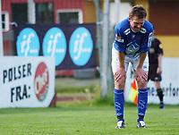 Christian Steen, Aalesund, fortviler etter å ha misset på straffespark. <br /> <br /> Fotball: Kongsvinger - Aalesund 2-2 (5-2 e. straffer). NM 2004 herrer, 3. runde. 8. juni 2004. (Foto: Peter Tubaas/Digitalsport.