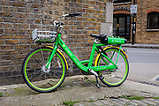 A Lime E dockless Electric Bicycle is seen on a street in east London, England on April 29, 2019. The Green pay as you ride bikes called Lime-E which are backed by Uber and Google can be found and unlocked via a mobile phone application.