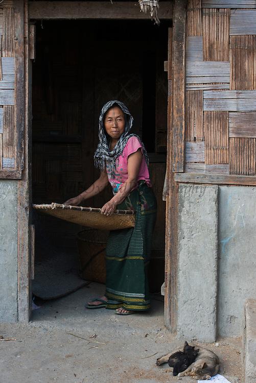 Apatani winnowing rice using Yapyo made of bamboo<br /> Apatani Tribe<br /> Ziro Valley, Lower Subansiri District, Arunachal Pradesh<br /> North East India