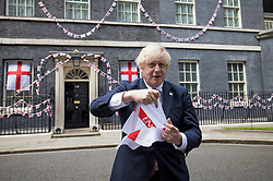 © Licensed to London News Pictures. 09/07/2021. London, UK. British Prime Minster BORIS JOHNSON is seen fumbling with a flag as he takes part in a stunt outside number 10 Downing Street, ahead of the Euro 2020 Championship final between England and Italy on Sunday.. Photo credit: Ben Cawthra/LNP