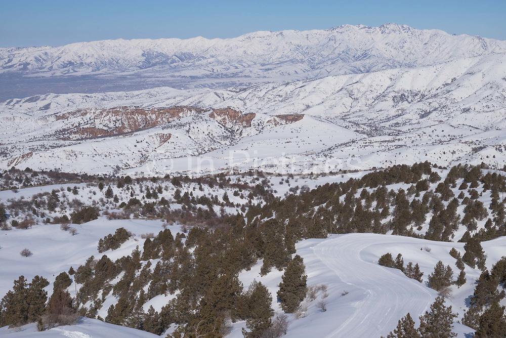 Over looking Beldersay ski resort from Mount Kumble on 26th February 2014 in Uzbekistan. Mount Kumble peaks at 2300 metres.