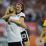 U.S. forward Lindsey Horan (25) and U.S. midfielder Erika Tymrak (23) hug after a goal during a women's soccer International friendly match between Brazil and the United States National Team, at the Florida Citrus Bowl  on Sunday, November 10, 2013 in Orlando, Florida. The U.S won the game by a score of 4-1.  (AP Photo/Alex Menendez)