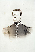 portrait of young adult man posing in military uniform France 1880s