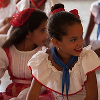 Central America, Cuba, Santa Clara. Cuban Girls in costume after dance performance.