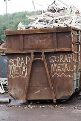 Skip full of scrap metal at a metal recycling centre,