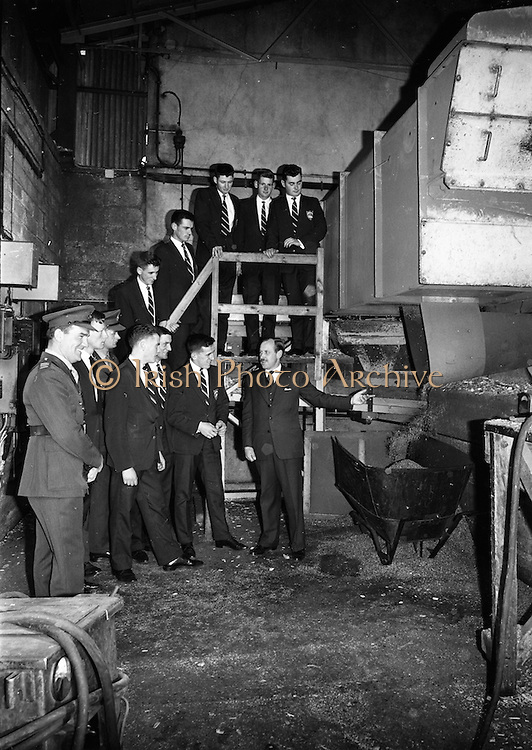 """18/10/1962<br /> 10/18/1962<br /> 18 October 1962<br /> Senior Military Cadets visit Bowaters Irish Wallboard Mills Ltd. at Athy, Co. Kildare. The Cadets from the Military College, on the first of many visits to Irish Industry as part of the curriculum outside of military studies. Mr. Victor Sadgrove, Sales Manager, Bowaters, guiding the cadets on a tour of the """"chipper house'. Included are: Captain H. Crowley, Training Officer; Lieutenant B. Studdert: Cadets,W. Hanlon; S. Duffy; W. Comber; M. Canavan; A. Eagar;  P. Mulligan;  S. Cummins; S. Duggan and J.P. Smyth."""