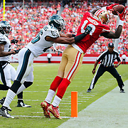 San Francisco 49ers wide receiver Steve Johnson (13) makes a touchdown catch against Philadelphia Eagles cornerback Cary Williams (26) during the NFL week 4 regular NFL game on Sunday, Sept. 28, 2014 in Santa Clara, Calif. The 49ers won the game 26-21. (AP Photo/Ric Tapia)