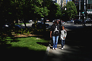 Dee walks with her son N, 8, to Denny Park, a popular hangout for the homeless families living at Mary's Place. Taking the kids to the park gives Dee some time to herself, while they run around and play.