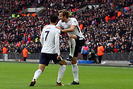 Harry Kane of Tottenham Hotspur celebrates with teammate  Son Heung-min after Kane scores his teams fifth goal (his 3rd). Premier league match, Tottenham Hotspur v Southampton at Wembley Stadium in London on Boxing Day Tuesday 26th December 2017.<br /> pic by Steffan Bowen, Andrew Orchard sports photography.