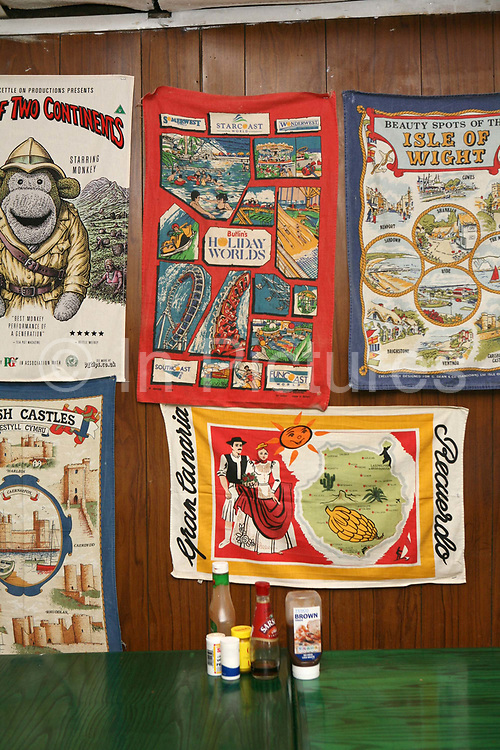 Tea towels decorate the walls at The Shack roadside cafe on the 16th June 2008 in Hook in the United Kingdom.