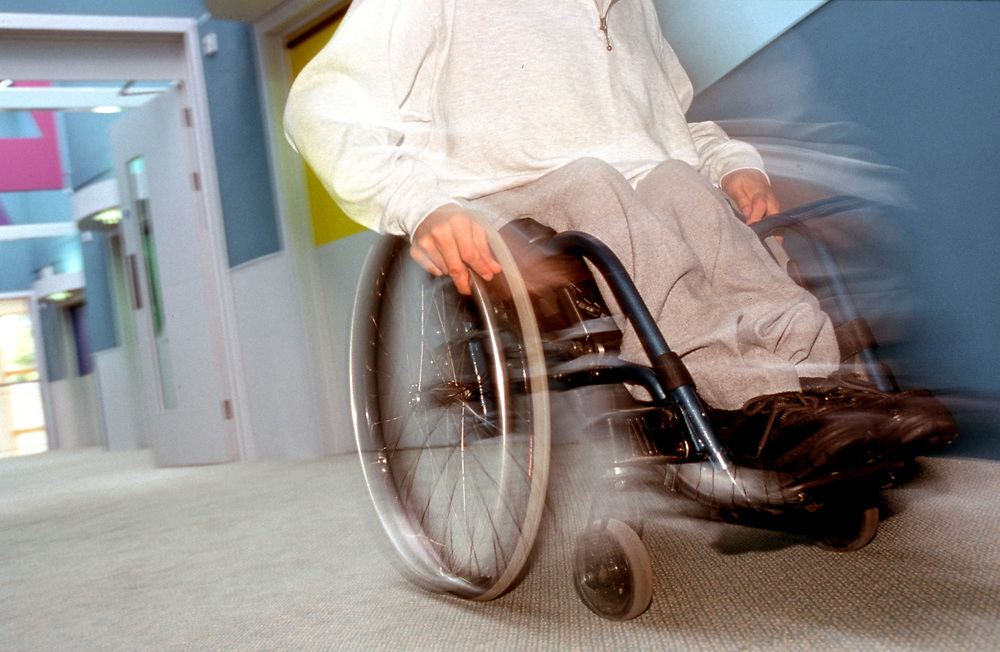 Disabled male in wheel chair in a residential home,
