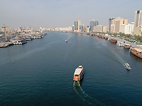 Aerial view of a wooden dhow in Dubai canal, United Arab Emirates.