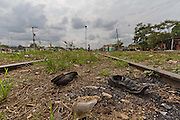 """Shoes and other belongings remain in the train tracks after  """"La Bestia""""'s departure. (Photo: Prometeo Lucero)"""