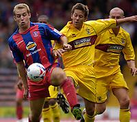 Photo: Daniel Hambury.<br />Crystal Palace v Burnley. Coca Cola Championship. 26/08/2006.<br />Palace's James Scrowcroft (L) and Burnley's John Hurley battle
