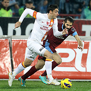 Trabzonspor's Halil Altintop (R) and Galatasaray's Albert Riera Ortega during their Turkish superleague soccer derby match Trabzonspor between Galatasaray at the Avni Aker Stadium in Trabzon Turkey on Sunday, 23 December 2012. Photo by TURKPIX